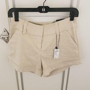 Express tan midi low rise shorts